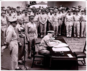 A66.334 Nimitz signing Japanese surrender Sept 2 1945 lo res
